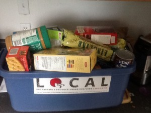 Tanis gathers food for Sooke's Food Bank from her pantry.