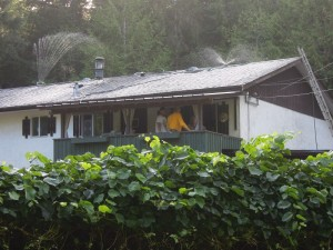 Sprinklers on a roof top, on a house along Otter Point Road. SPN Photo.