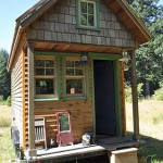 """Tiny house, Portland"" by Tammy - Weekend with Dee. Licensed under CC BY 2.0 via Commons - https://commons.wikimedia.org/wiki/File:Tiny_house,_Portland.jpg#/media/File:Tiny_house,_Portland.jpg"