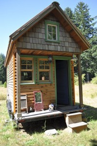 """""""Tiny house, Portland"""" by Tammy - Weekend with Dee. Licensed under CC BY 2.0 via Commons - https://commons.wikimedia.org/wiki/File:Tiny_house,_Portland.jpg#/media/File:Tiny_house,_Portland.jpg"""