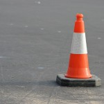 Unaltered image from https://pixabay.com/en/caution-cone-orange-traffic-white-389408/