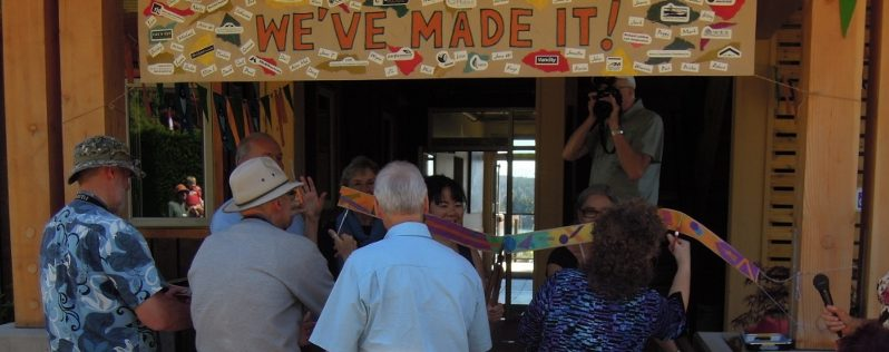 In true co-housing form, the ribbon was cut collectively. SPN photo.