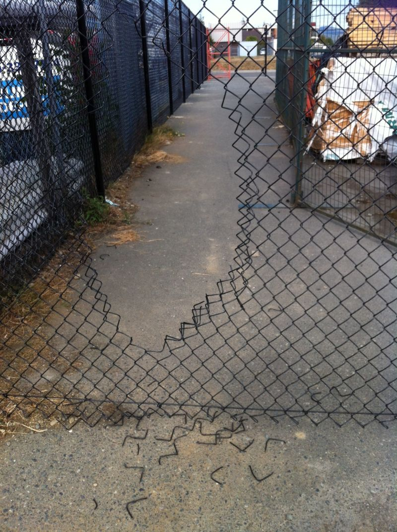 Vandals Hack Hole Through Home Hardware Chainlink Fence