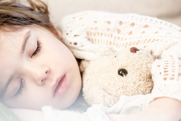Open use image from https://www.pexels.com/photo/girl-sleeping-with-her-brown-plush-toy-101523/